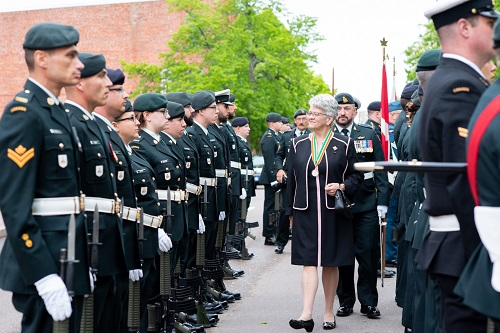 Her Honour, Antoinette Perry, inspects the honour guard.